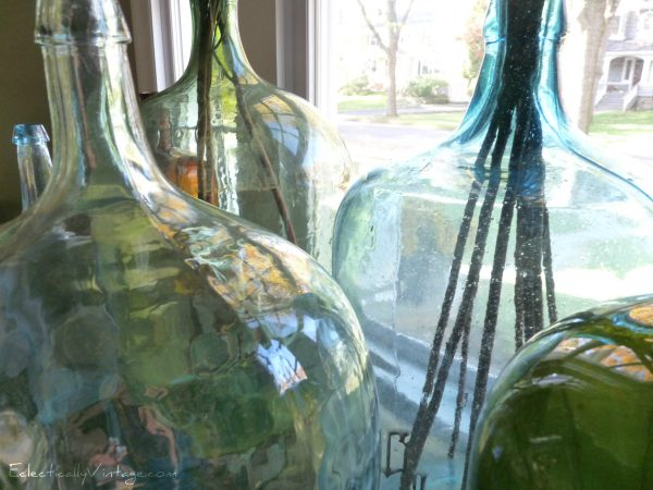 Vintage demijohn collection - this house has the best collections!  eclecticallyvintage.com