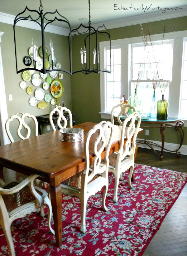Dining Room - love the mix of collections and furniture (and that plate wall)!  kellyelko.com