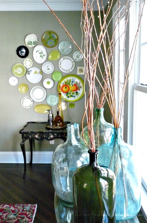Eclectic plate wall - you have to see this dining room!  eclecticallyvintage.com