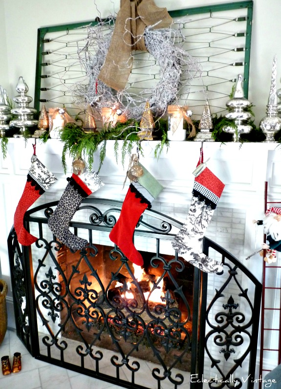 Crib spring Christmas mantel - love this festive look!  kellyelko.com