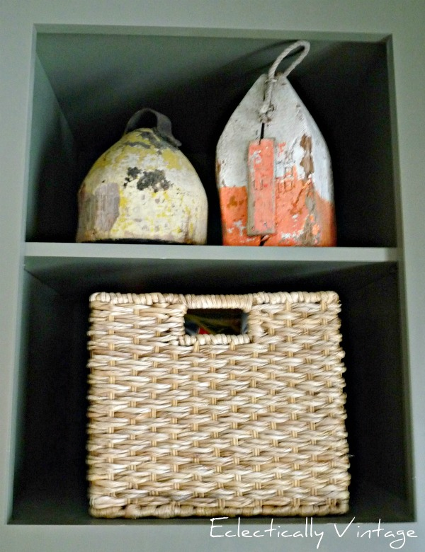 Vintage buoy collection in this gorgeous mudroom kellyelko.com