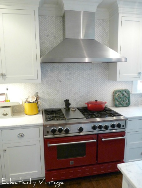 Red oven - focal point in this white cottage kitchen.  kellyelko.com