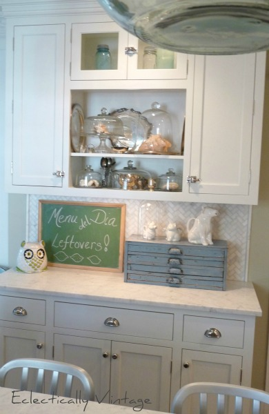 white built-in storage kitchen
