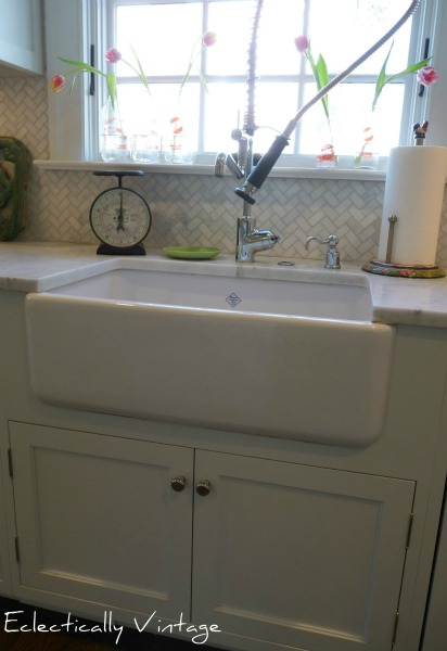 Shaws farmhouse sink - fabulous in this white kitchen.  eclecticallyvintage.com
