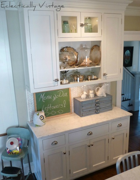 Open kitchen shelving built in in a gorgeous white kitchen with attention to detail.  eclecticallyvintage.com