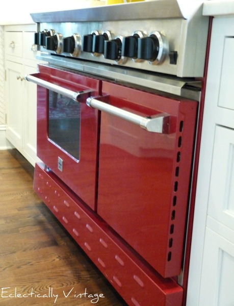 Red BlueStar stove - this is a showstopper in this white kitchen.  eclecticallyvintage.com