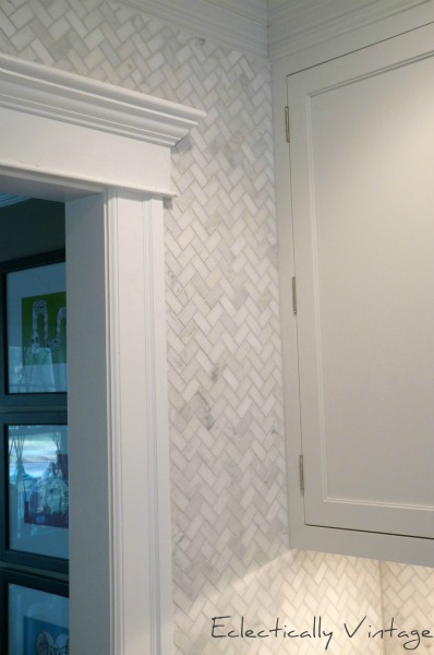 Herringbone marble tile to the ceiling for a custom look in this kitchen.  eclecticalyvintage.com