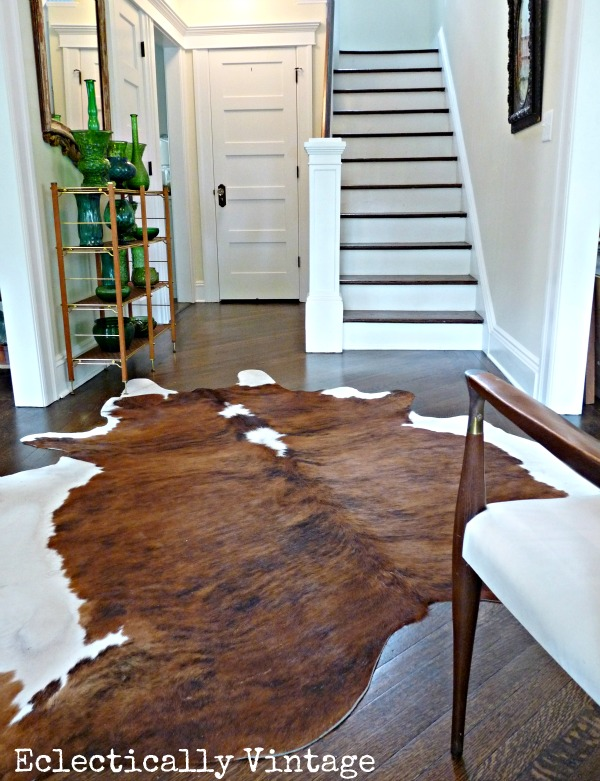 Gorgeous foyer - love the cowhide and the glass collection eclecticallyvintage.com