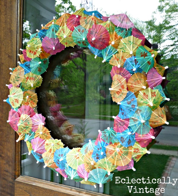 Make a Paper Parasol Wreath - how fun!  eclecticallyvintage.com
