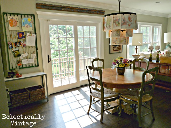 Kitchen nook - love the map chandelier!  kellyelko.com