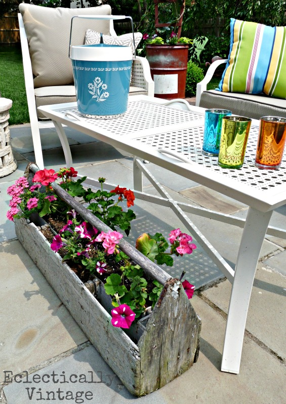 Eclectic patio - love the mixture of new and vintage pieces and the creative planters!  eclecticallyvintage.com