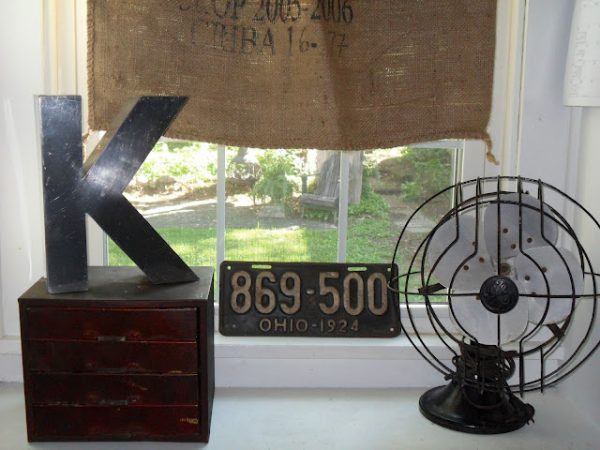 She has the best vintage finds and knows how to show them off - love the old fan! kellyelko.com
