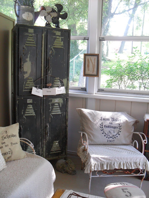 Love this sunroom and the old locker! kellyelko.com