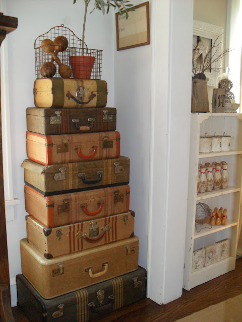 Vintage suitcase collection - she knows how to display the best vintage finds! kellyelko.com