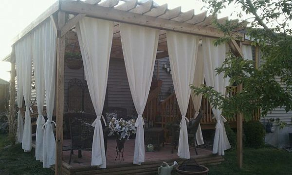 Love this pergola with the curtains for privacy - so pretty! kellyelko.com