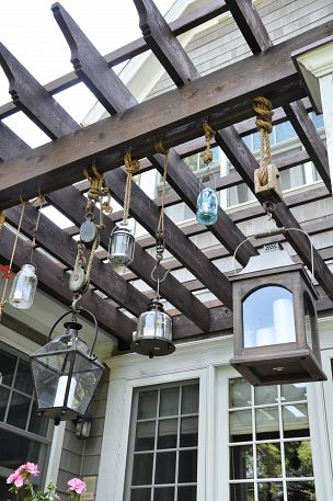 Love these Pottery Barn lantern knockoffs - fun hanging from the pergola kellyelko.com