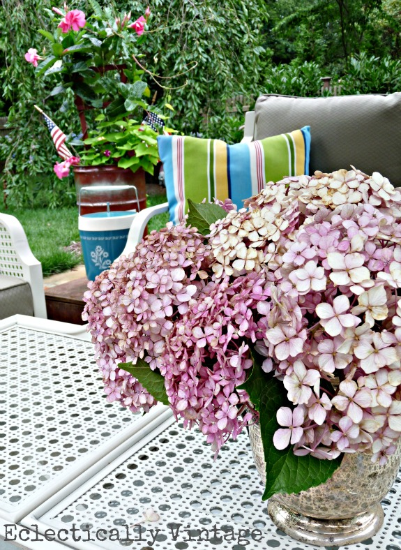 Beautiful patio furniture - love the hydrangeas too kellyelko.com