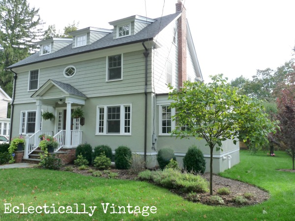 Love the curb appeal of this old house - the dormers, the porch, the railings, the windows! kellyelko.com
