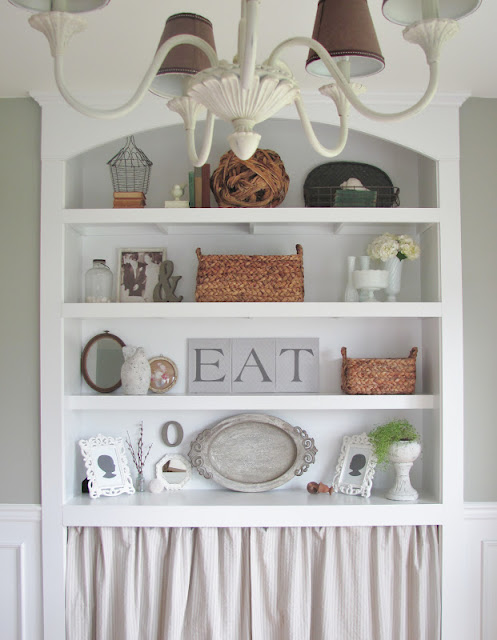 Dining room hutch - love the collections and neutral decor kellyelko.com