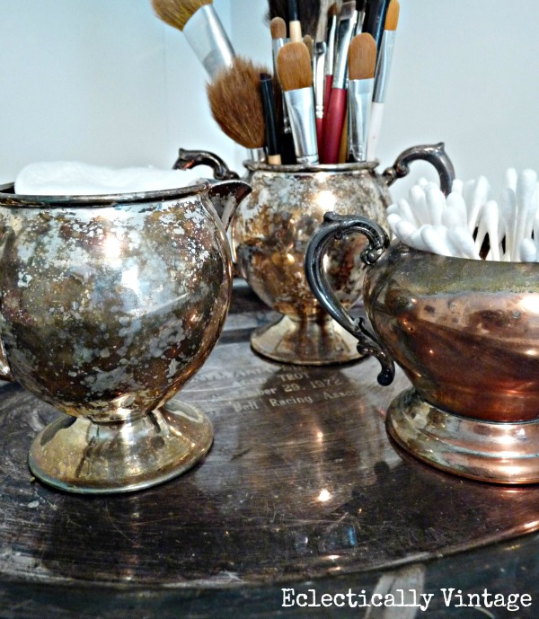Vintage Storage ideas for the bathroom - love the old silver for necessities.  kellyelko.com