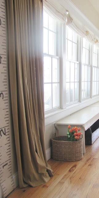 Neutral drapes and a fun growth chart in this stunning coastal home kellyelko.com