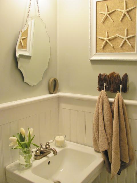 Easy DIY artwork with starfish in this coastal bathroom kellyelko.com