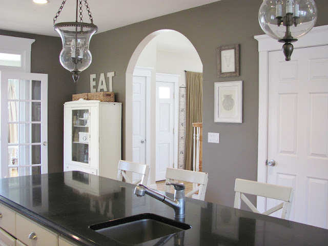 Farmhouse kitchen - love the paint color and two glass pendant lights kellyelko.com