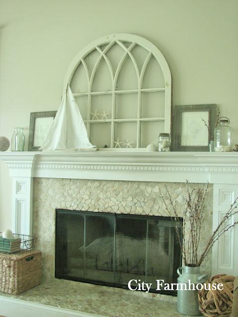 Love this coastal mantel with vintage window and stone fireplace surround kellyelko.com