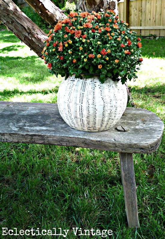 DIY Halloween music sheet planter from a plastic pumpkin!  Perfect fall decorations at kellyelko.com