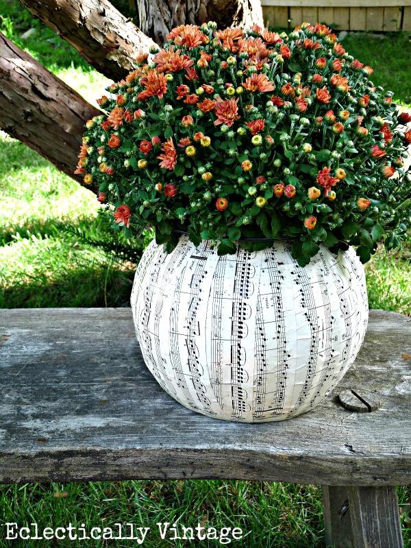 DIY Halloween music sheet planter from a plastic pumpkin!  kellyelko.com