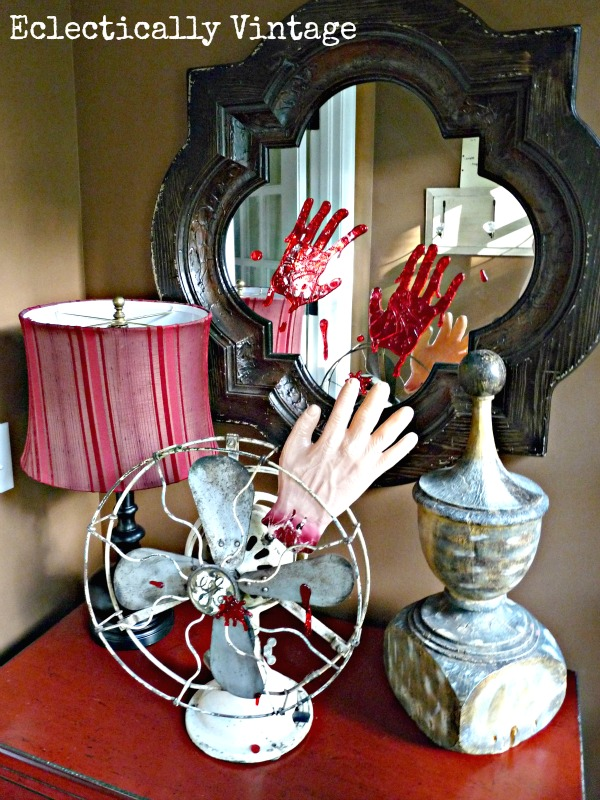Gory Halloween Decorating Ideas - poor fellow lost his hand!  eclecticallyvintage.com