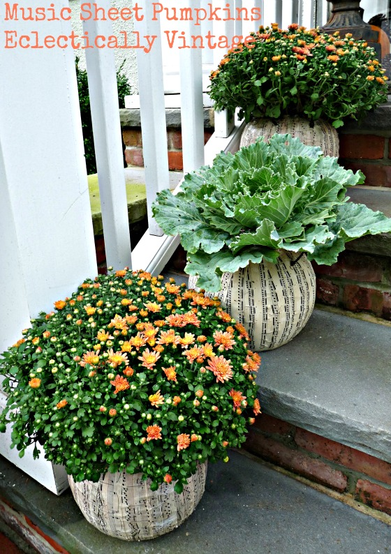 Fall Porch Decorating - tons of great DIY ideas here like these music sheet pumpkin planters!  eclecticallyvintage.com