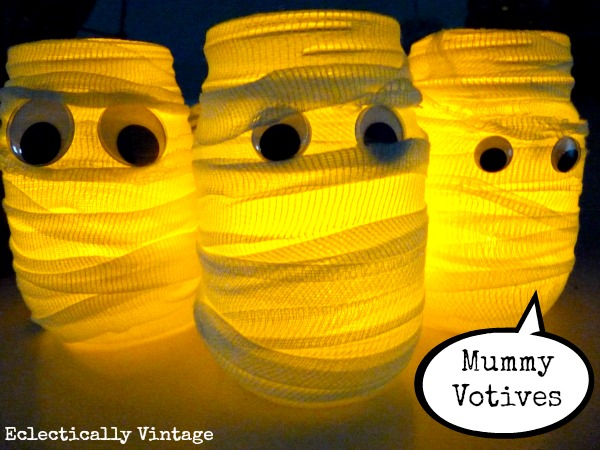 Halloween House Tour - tons of creative #Halloween decorations like these DIY #mummy votives!  kellyelko.com