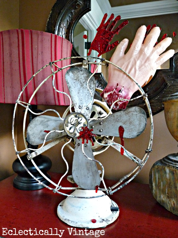 Halloween House Tour - tons of creative #Halloween decorations like this severed hand fan!  eclecticallyvintage.com
