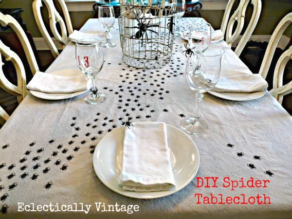 Halloween House Tour - tons of creative #Halloween decorations like this DIY spider tablecloth!  eclecticallyvintage.com