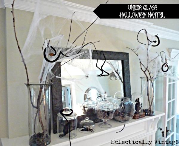 Under Glass Halloween Mantel Ideas - this is creepy crawly!  kellyelko.com