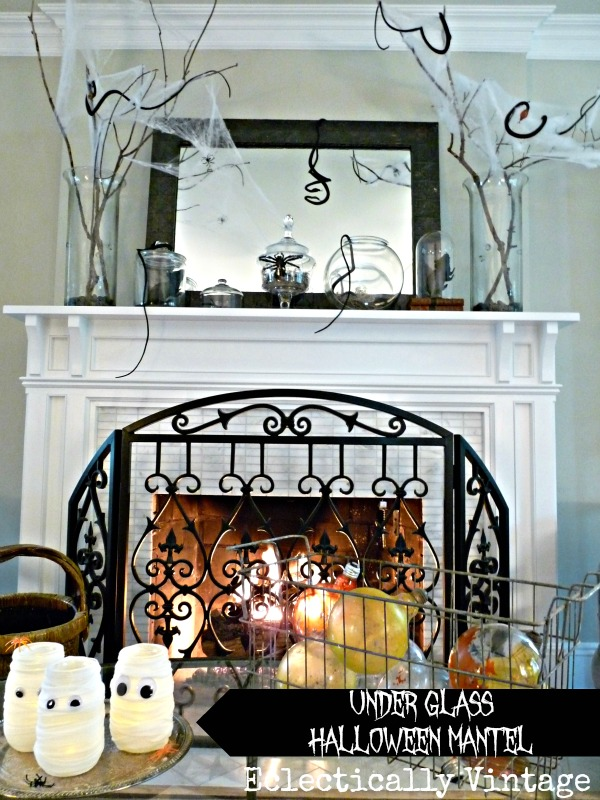 Under Glass Halloween Mantel Ideas - this is creepy crawly!  eclecticallyvintage.com