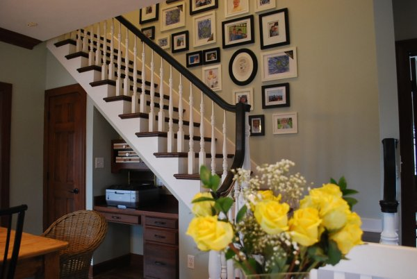 Stairway Gallery Wall - love the mix of frames, art and photos