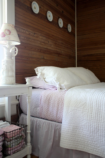 Farmhouse bedroom - love the wood walls