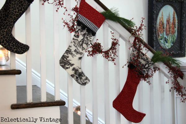 Christmas House Tours - step inside this 100 year old home filled with tons of fabulous decorating ideas like this stocking bannister!  eclecticallyvintage.com