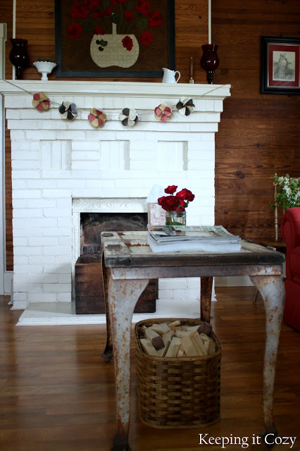 Great metal table and fireplace in this old farmhouse
