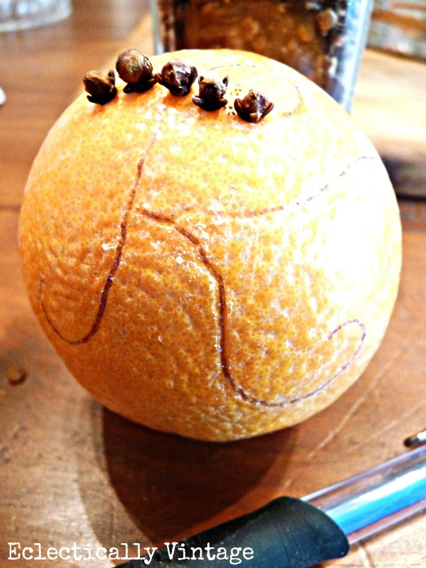 Make an orange pomander - great for the holidays (and smells divine)!  kellyelko.com