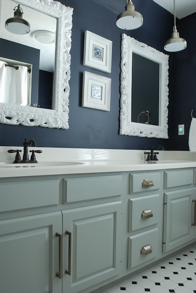 Bold Bathroom - love the dark walls with the white frames