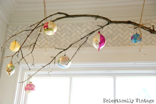Christmas House Tours - step inside this 100 year old home filled with tons of fabulous decorating ideas like this branch window treatment!  eclecticallyvintage.com