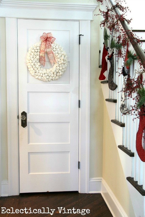 Love the bannister with Christmas stockings and that marshmallow wreath she made! kellyelko.com