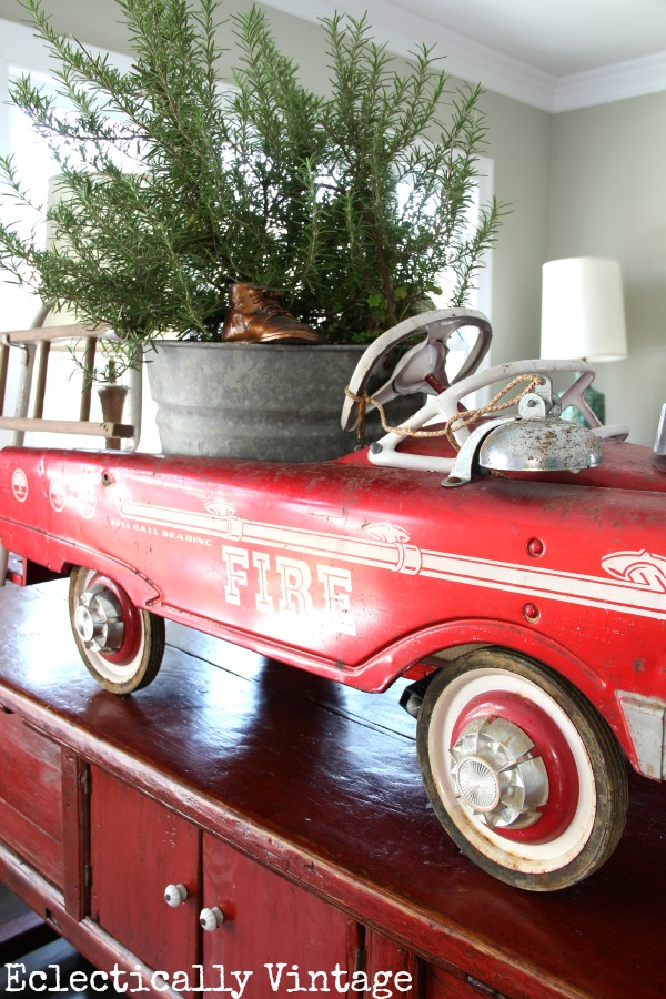 Christmas House Tours - step inside this 100 year old home filled with tons of fabulous decorating ideas like this vintage fire truck!  kellyelko.com