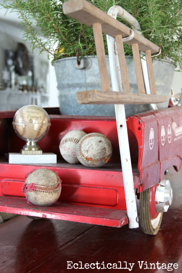 Christmas House Tours - step inside this 100 year old home filled with tons of fabulous decorating ideas like this vintage fire truck!  eclecticallyvintage.com