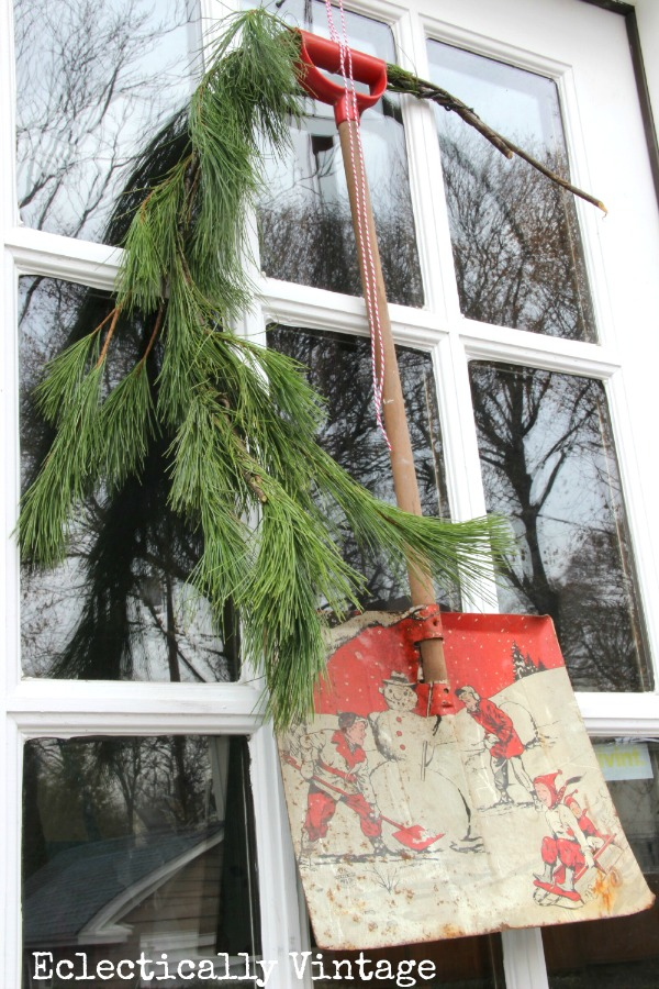 Christmas House Tours - step inside this 100 year old home filled with tons of fabulous decorating ideas like this vintage toy snow shovel wreath!  kellyelko.com