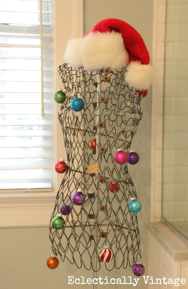 Christmas House Tours - step inside this 100 year old home filled with tons of fabulous decorating ideas like this vintage dress form!  eclecticallyvintage.com