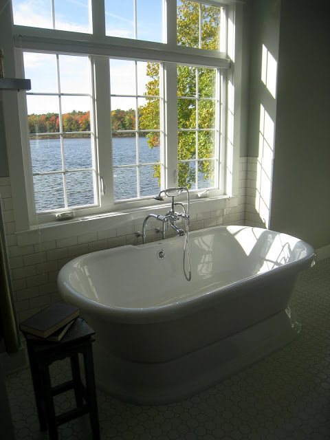 Gorgeous white #bathroom - part of this lake house home kellyelko.com